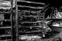 Burned damaged ruins of destroyed supermarket arson investigation insurance. Damaged industry supermarket after arson fire with burn debris of twisted metallic royalty free illustration