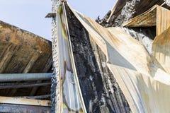 Burned damaged ruins of destroyed supermarket arson investigation insurance stock image