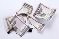Burned dollar bills. Stock Photography