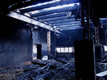 Burned down 1. Shot of a burned down interior. The ashes were still hot and mist was in the air, which gave the scene a very dramatic feeling. No this was not my Royalty Free Stock Photos
