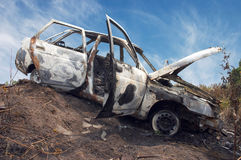 The burned down automobile. The automobile after a fire, completely burned down Stock Image