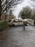 Burned down car on the pedestrian bridge in France stock images