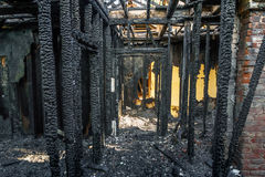 Burned down wooden apartment house, charred walls, burnt roof Stock Images