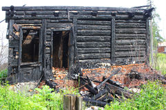 Burned down wooden house, charred walls, burnt roof, Stock Photography