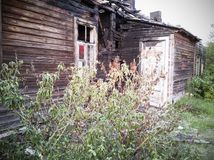 burned-down wooden house stock photography