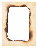 Burned Edges Paper Frame. A frame or border formed from a very old, creased paper with the center burned away leaving a blank space. Isolated on white stock photo