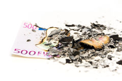 Burned euro note in ash Stock Images