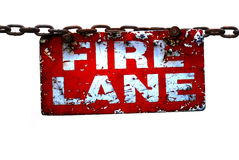 Burned Fire Lane Sign, Isolated on White. A haggard, burned fire lane sign dangles on an old rusted chain. Isolated on White Royalty Free Stock Photography