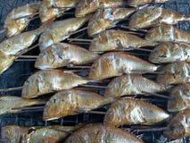 Burned fish with smoke Royalty Free Stock Image