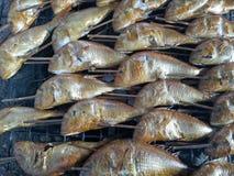 Burned fish with smoke Royalty Free Stock Photo