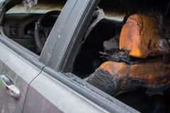 Burned gray car. Royalty Free Stock Photos