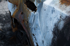 Burned gray car. Royalty Free Stock Images