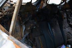 Burned gray car. Stock Photos
