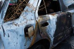 Burned gray car. Royalty Free Stock Photo
