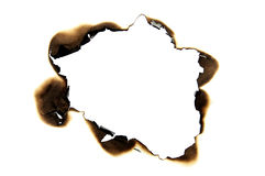 Burned hole. On a white paper background Stock Photos