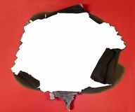 Burned Hole In Red Paper Royalty Free Stock Image