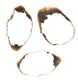 Burned holes Stock Photography
