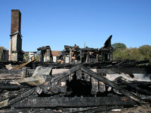 Burned Home. Charred remains of historic home which had burned down hours earlier stock photography