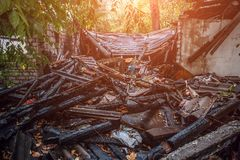 Burned house, ruins of destroyed building by fire, arson concept Stock Photos