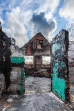 Burned house. Image of a burned abandoned house in an urban setting with overcast sky Stock Photos