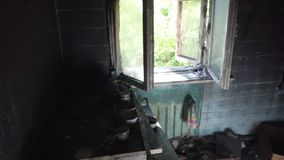 Burned house inside. Kitchen room and furniture stock video footage