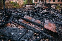 Burned house, ruins of destroyed building by fire, arson concept Stock Photo