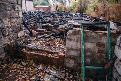 Burned house, ruins of destroyed building by fire, arson concept Stock Images