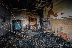 Burned interiors of industrial hall after fire in the factory Royalty Free Stock Photos