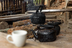 Burned kettle for black coffee. Burned kettle for black coffee in a small mountain village in Thailand. Thai traditional old style coffee Stock Photo