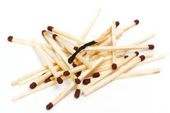 Burned match. Heap of matches and one burned down Stock Photos