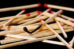 Burned match stick. One burned match stick, as an allegory Royalty Free Stock Photo