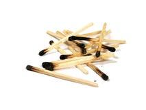 Burned matches. Some burned matches on white background royalty free stock image