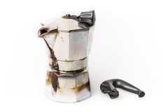 Burned Moka pot. Vintage Moka pot forgotten on the fire. Burned with in molten plastic components royalty free stock image
