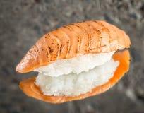 Burned nigiri sushi with salmon Stock Photography