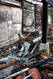 Burned Out Building and Debris after Fire Disaster Stock Images