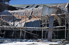 Burned out building. A burned out retail store against a blue sky Royalty Free Stock Images