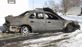 Burned out car. A car destroyed by fire Royalty Free Stock Image