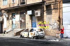 Burned-out car on a city street. Stock Images