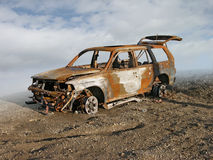 Burned Out Car. Photo illustration of a burned and rusted out car Stock Photo