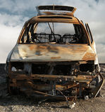 Burned Out Car. Photo illustration of a burned and rusted out car Royalty Free Stock Photography