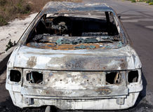 Burned out car in street Royalty Free Stock Photography