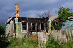 Burned-out house. Charry wooden house with chimney in the Russian village Royalty Free Stock Image