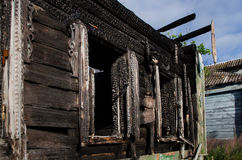 Burned-out house. Charry wooden house in the Russian village Royalty Free Stock Photography