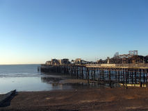 Burned-out pier. Bearing the burnt pier in England in the town Hastings Royalty Free Stock Photography