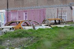 Burned out stolen cars abandoned on wasteland in centre of Dublin city, Ireland stock photos