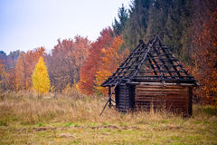 A burned out wooden house Stock Images