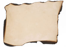 Burned paper. Stressed paper burned at the edges to simulate an old treasure map background Royalty Free Stock Photo