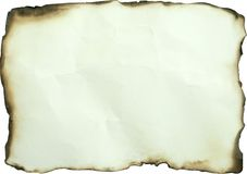 Burned paper. Old yellow burned paper on white background Royalty Free Stock Photos