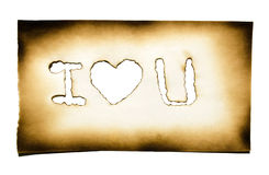 Burned paper with heart and. I love you text in burned hole on white background with clipping path Stock Photography
