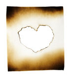 Burned paper with heart in burned hole. On white background with clipping path Royalty Free Stock Photo